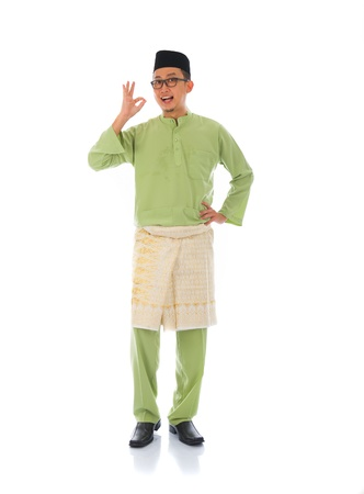 malay village: indonesia male with ok sign during ramadan isolated white background Stock Photo