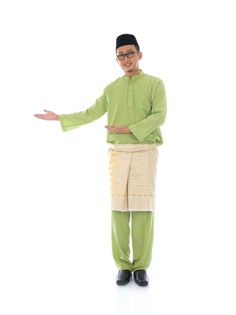 Traditonal Malay man with welcome gesture during ramadan isolated white background   Imagens
