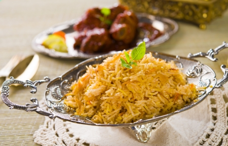 Briyani mutton rice papadam with traditional background photo
