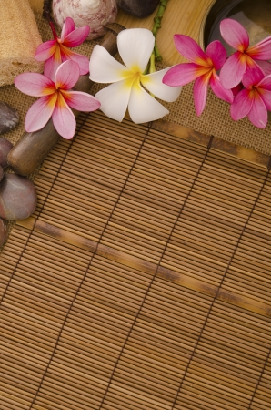 low relief: tropical spa setup with traditional frangipani flower and massage items