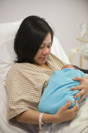 childbirth: Asian mother and newborn baby girl in hospital   Stock Photo