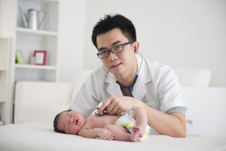 asian male doctor and newborn baby on the clinic  photo