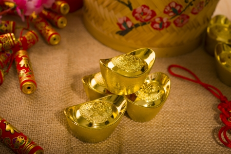 Chinese new year with decoration, large gold ingot and mandarin oranges