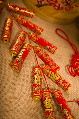 fire crackers: Traditional chinese new year fire crackers on the red. Stock Photo