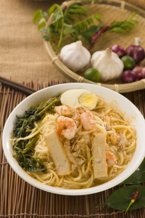Prawn mee, prawn noodles. Famous Malaysian food spicy fresh cooked har mee in clay pot with hot steam.   photo