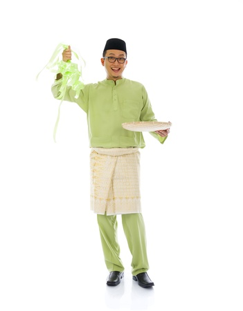 indonesian male with ketupat during ramadan festival with isolated white background   photo
