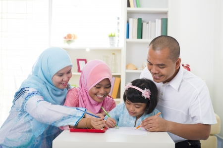 indonesian woman:  indonesian muslim family learning together with lifestyle background   Stock Photo