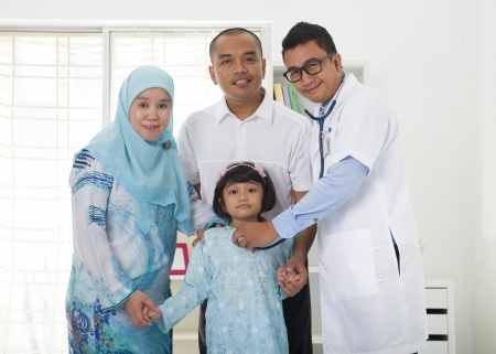 family practitioner: malay family visiting the doctor Stock Photo
