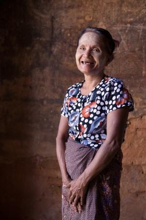 happy senior asian burmese woman in bagan photo