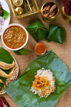 nasi: nasi lemak bungkus, a traditional malay curry paste rice dish served on a banana leaf   Stock Photo