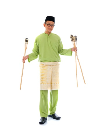 Malay man celebrating hari raya the month after ramadan   photo