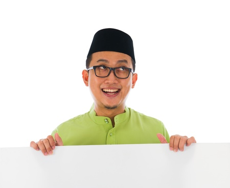 malaysia culture: malay male with blank card during hari raya Eid al-Fitr celebration   Stock Photo