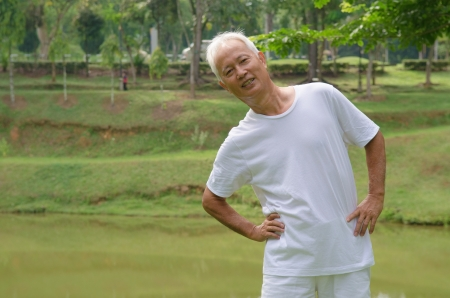 asian senior male workout in the park   photo