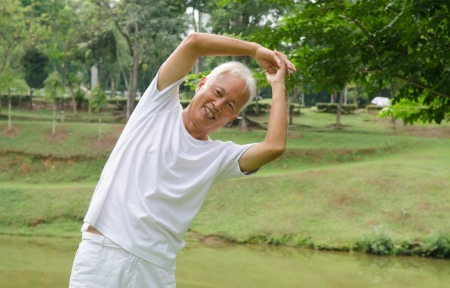 asian senior male workout in the park