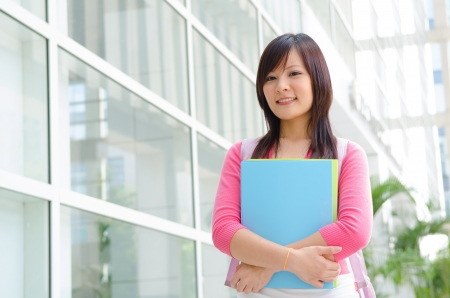asian chinese college female student with campus background photo