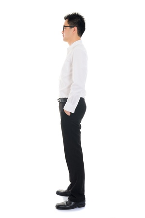 Young Asian business man full body side view isolated on white background photo