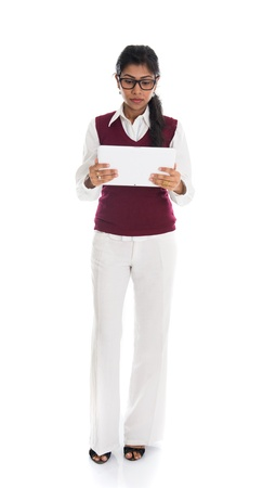 modern indian businesswoman using tablet computer over white background   photo