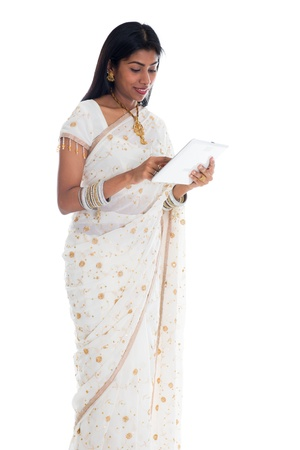 indian saree: traditional indian woman in sari using tablet computer   Stock Photo