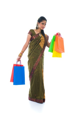 traditional South Indian woman holding Deepavali shopping bags and smiling   photo