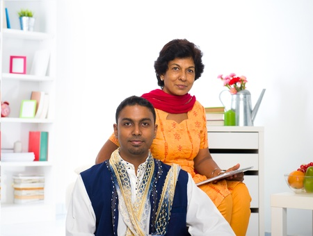 dhoti: indian mother and son in the living room Stock Photo