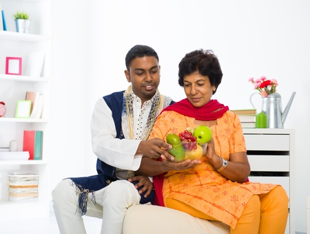 healthy indian mother and son dining photo