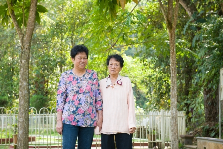 Asian senior females walking in the park photo
