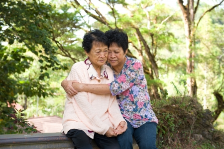 consoling: asian female senior crying and having depression