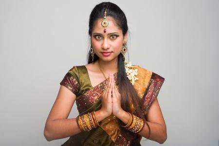 sari: traditional indian female giving greetings during diwali Stock Photo