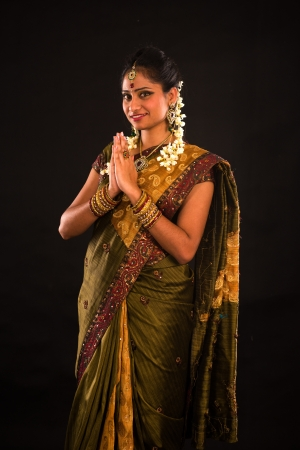 traditional indian female greeting with dark background Stock Photo