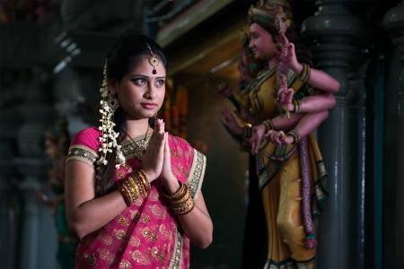 indian saree: traditional Young indian girl praying in the temple