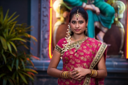 indian saree: traditional Young indian womanin the temple   Stock Photo