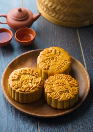Mooncake for Chinese mid autumn festival foods. The Chinese words on the mooncakes means assorted fruits nuts, not a logo or trademark. photo