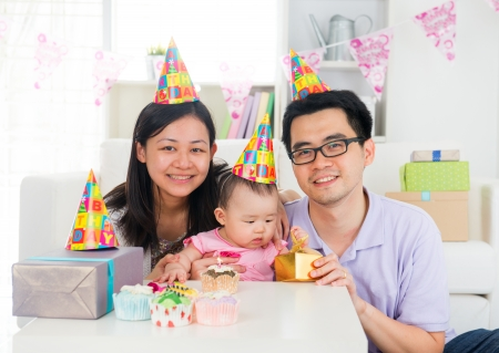 chinese hat: chinese family celebrating baby birthday party ,full moon