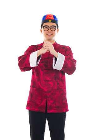 Asian man with Chinese traditional dress cheongsam and gong xi fa cai greetings Stock Photo - 22484805