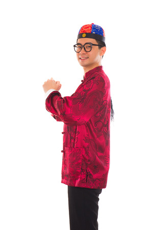 Asian man with Chinese traditional dress cheongsam and gong xi fa cai greetings Stock Photo - 22484548