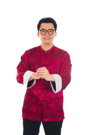 Asian man with Chinese traditional dress cheongsam and gong xi fa cai greetings Stock Photo - 22483677