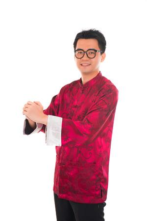 gong xi fa cai: Asian man with Chinese traditional dress cheongsam and gong xi fa cai greetings