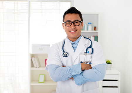 malay male doctor in the clinic photo