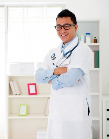indonesian male doctor in the clinic , smiling happy Stock Photo