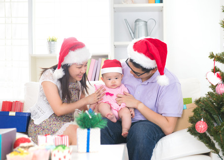 Asian young family celebrating christmas   photo