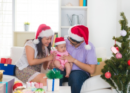 asian baby girl: Asian chinese young family celebrating christmas Stock Photo