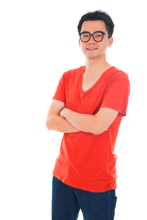 khakis: casual confident looking asian male with isolated white background , half body   Stock Photo