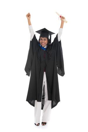 nepali: female indian graduate celebrating success isolated on white background Stock Photo