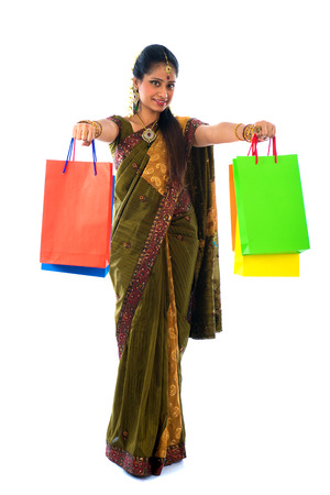 traditional indian woman doing diwali shopping with isolated white background photo