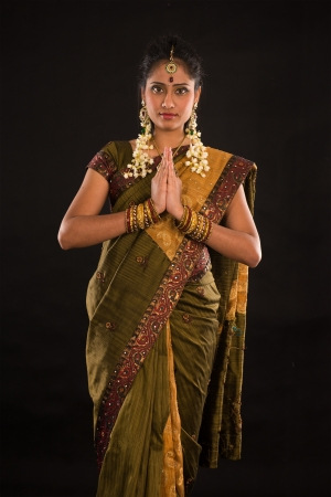 indian female in traditional saree dress and diwali greeting