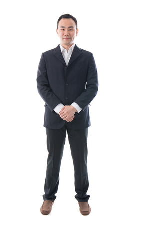 Full body portrait of happy asian business man. Stock Photo - 22847995