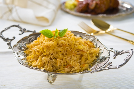 chicken biryani served with crockery photo