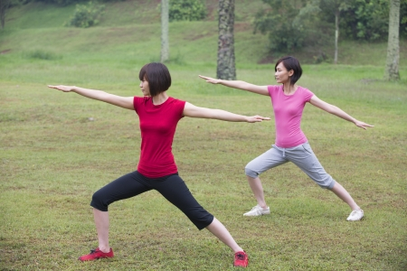 asian girls working out outdoor park photo