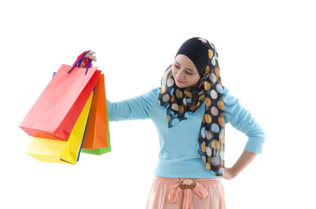 malay indonesian girl with shopping bags photo
