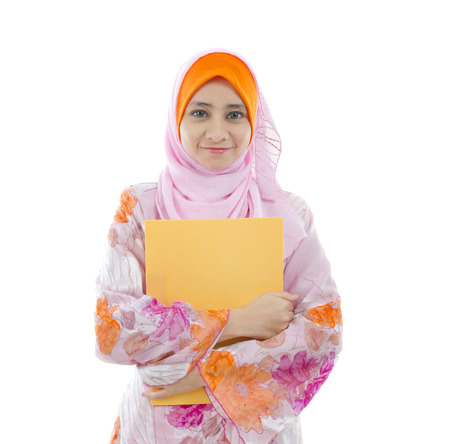 malay indonesian college girl holding a folder